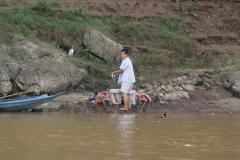 Mosó nő a Mekongnál